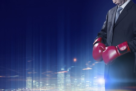 protective suit: Determined businessman in suit and boxing gloves Stock Photo