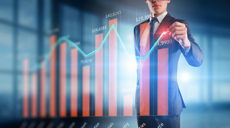 Close view of businessman drawing on screen market infographs Stock Photo