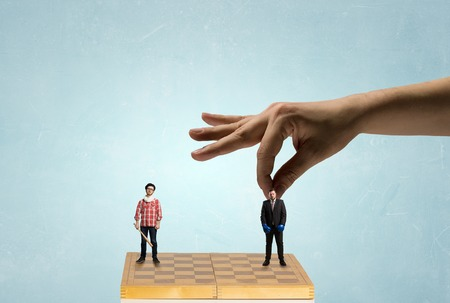 coworker: Business people on chess board fighting each other. Mixed media Stock Photo