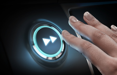press button: Close of hand pushing glowing blue button Stock Photo