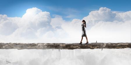 impediment: Blind businesswoman walking on wooden log above gap. Risk and challenge concept