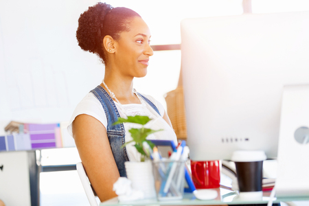 afroamerican: Portrait of beautiful smiling afro-american office worker in office Stock Photo