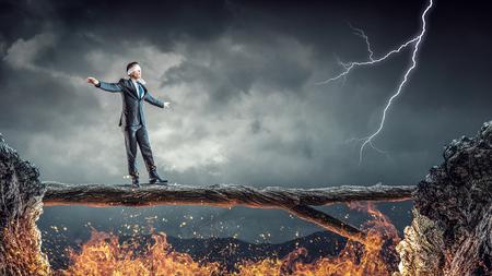 impediment: Blind businessman walking on log over gap. Risk and challenge concept