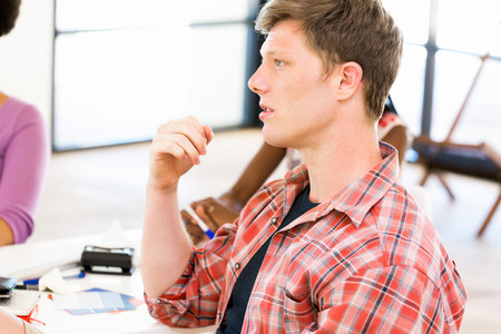 Young man in casual clothes in an office Stock Photo