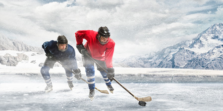 Ice hockey players on the ice outdoors