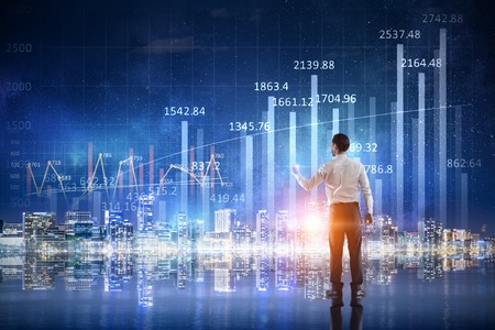 Businessman working on virtual panel with digital infographs