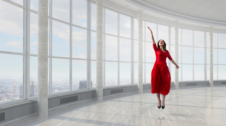 mixed media: Beautiful woman in red dress reaching hand in gesture. Mixed media Stock Photo