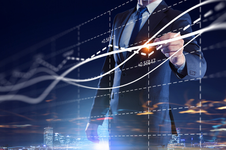 dynamic growth: Close view of businessman drawing on screen market infographs Stock Photo