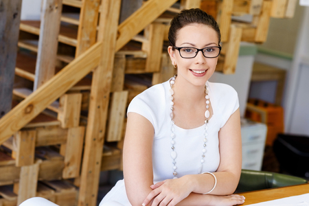 attractive  female: Young woman in casual clothes in an office with drafts