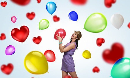 mixed media: Young woman in dress and hat with party balloons
