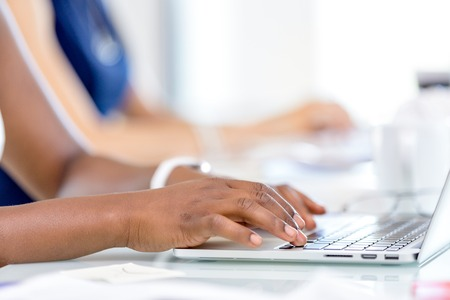 womans hands: Image of womans hands typing. Selective focus