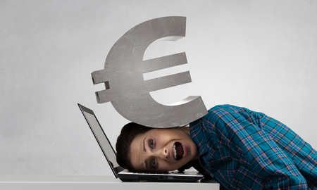 suppressed: Stressed woman with head under pressure of euro sign
