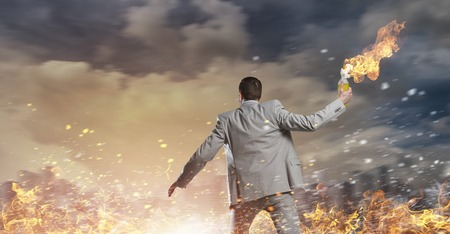 sabotage: Young aggressive businessman throw burning molotov cocktail