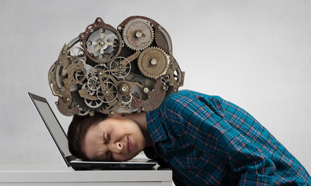 Stressed woman with head under pressure of mechanism
