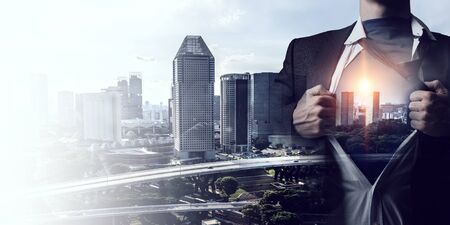 Exposure image of businessman super hero and modern city