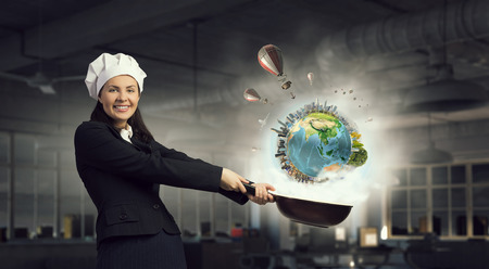 woman handle success: Young businesswoman in cook hat with pan in hand.