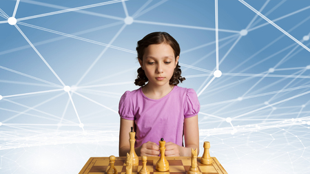 logical: Smart cute kid girl playing chess game developing logical thinking