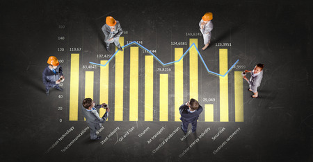 formalwear: Top view of business people in formalwear standing on infographs
