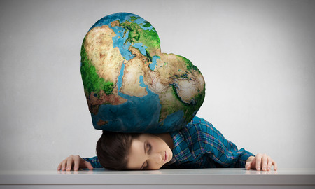 suppressed: Stressed woman with head under pressure of Earth planet. Elements of this image are furnished by NASA