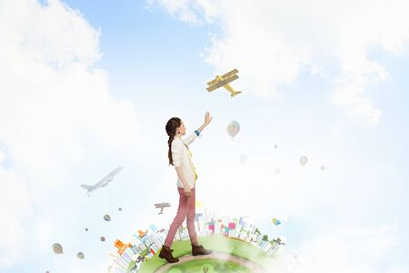 positivism: Young woman in casual in other reality reaching hand in gesture Stock Photo