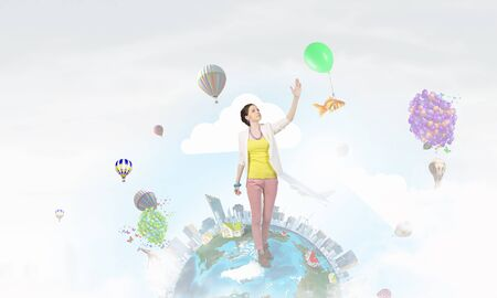 positivism: Young woman in casual reaching hand in gesture. Elements of this image are furnished by NASA