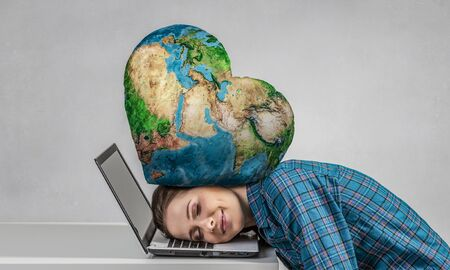 suppressed: Stressed woman with head under pressure of Earth planet. Stock Photo