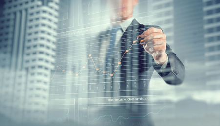 Exposure image of businessman drawing graph on screen. Mixed media Stock Photo
