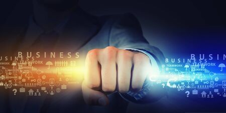 Hand of businessman holding in fist glowing light Stock Photo