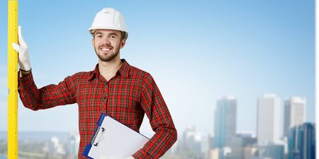 journeyman: Young handsome man in hardhat with measure level
