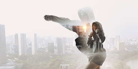 Young box fighter woman outdoor against cityscape Stock Photo