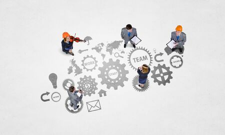 Top view of business people and gear mechanism as teamwork concept
