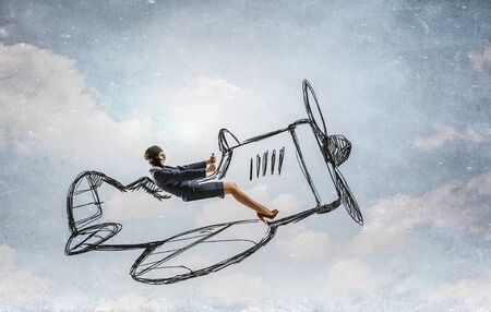 Woman in suit and helmet flying in drawn old styled airplane