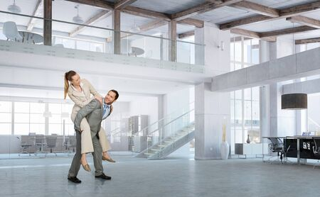 office slave: Businesspeople in office riding colleague back. Mixed media