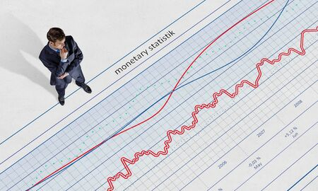 formalwear: Top view of businessman in formalwear standing on infographs Stock Photo