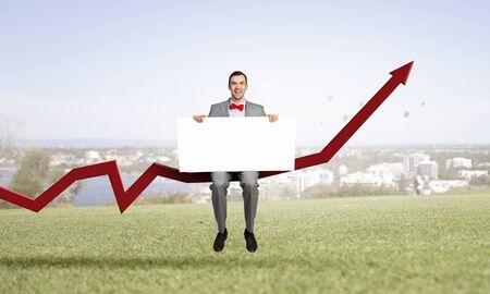 Businessman show white banner . Mixed media Stock Photo
