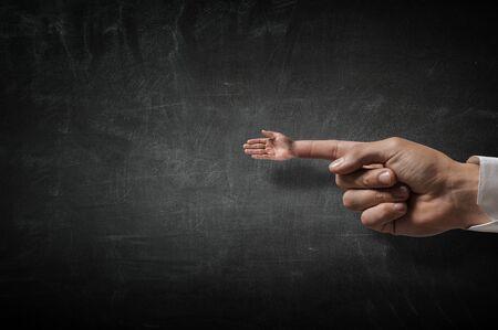 forefinger: Greeting gesture on forefinger . Mixed media Stock Photo