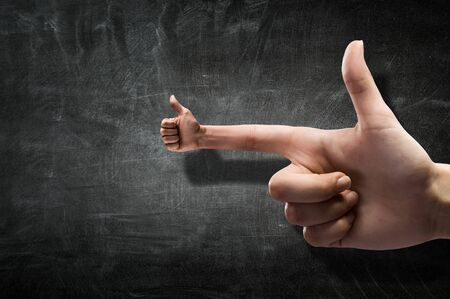forefinger: Closeup of male hand and thumb up on forefinger Stock Photo