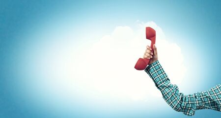 receiver: Telephone receiver in hand Stock Photo