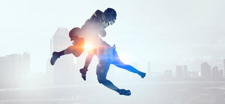 Exposure of American football players Stock Photo