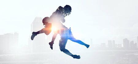 Exposure of American football players Stock Photo