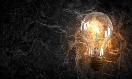 electric bulb: Electric bulb on texture . Mixed media Stock Photo