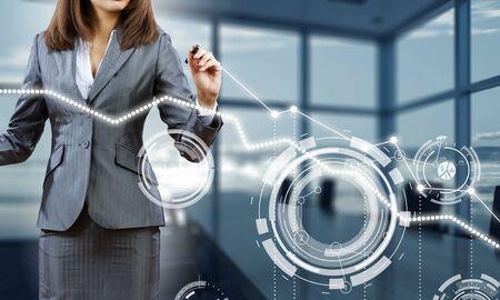 Businesswoman draw diagrams . Mixed media