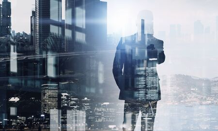Exposure of businessman and cityscape    . Mixed media