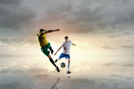 Soccer player outdoors . Mixed media Stock Photo