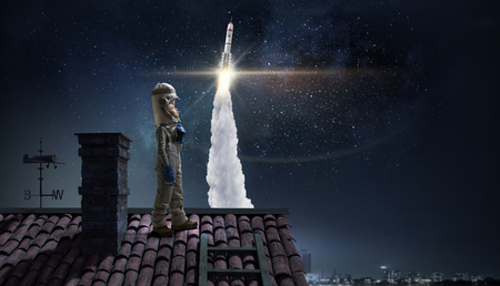 Dreaming of becoming a spaceman . Mixed media Stock Photo