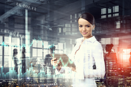 modern businesswoman: In rythm of modern tendencies Stock Photo