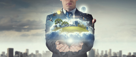 ownerships: Close up of businessman holding city model in hands