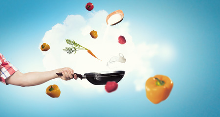 woman handle success: Person hand holding frying pan on white background