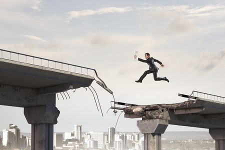 Business concept of businessman overcome the problems . Mixed media Stock Photo