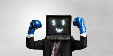 Monitor headed businessman . Mixed media